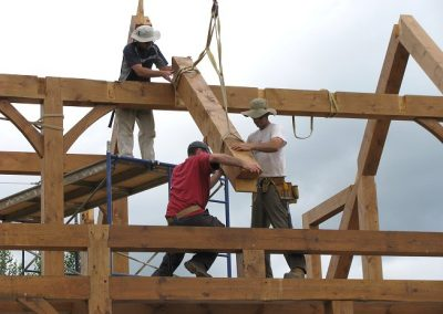 Workers raising a timber frame